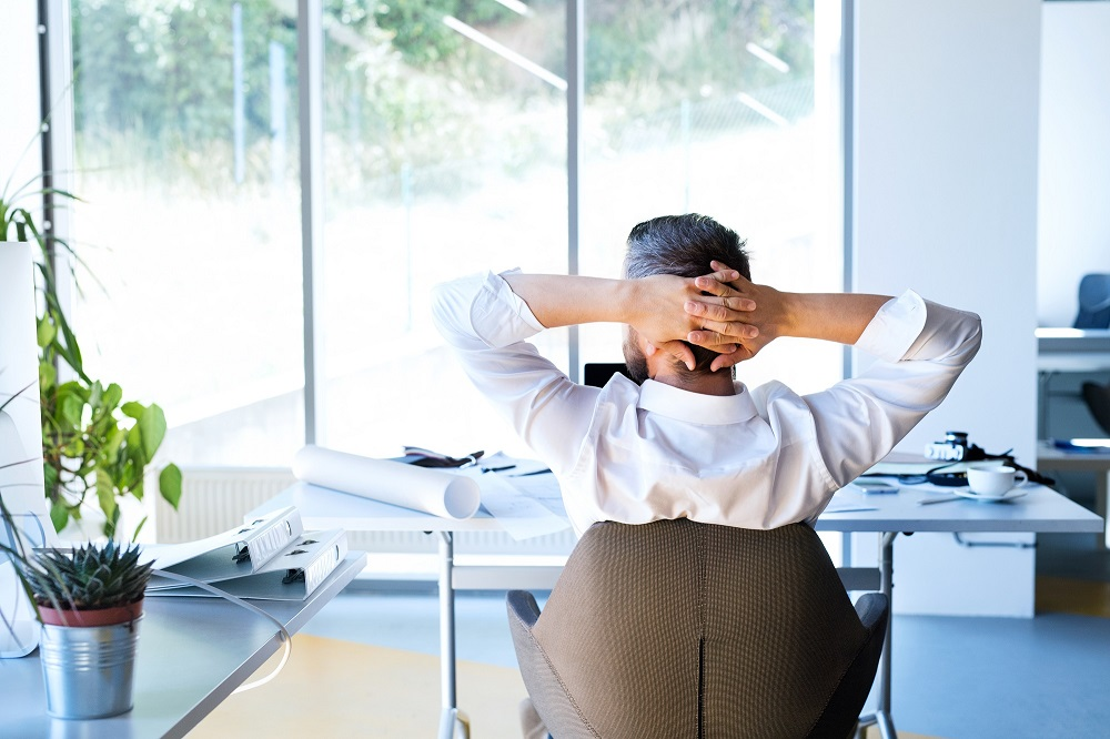 businessman-at-the-desk-in-his-office-resting-P2C7_c7e58a320093783f8a1037e6afe105c8